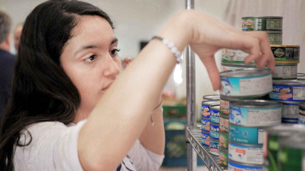 Young volunteer stocking groceries at the Arizona Kosher Pantry