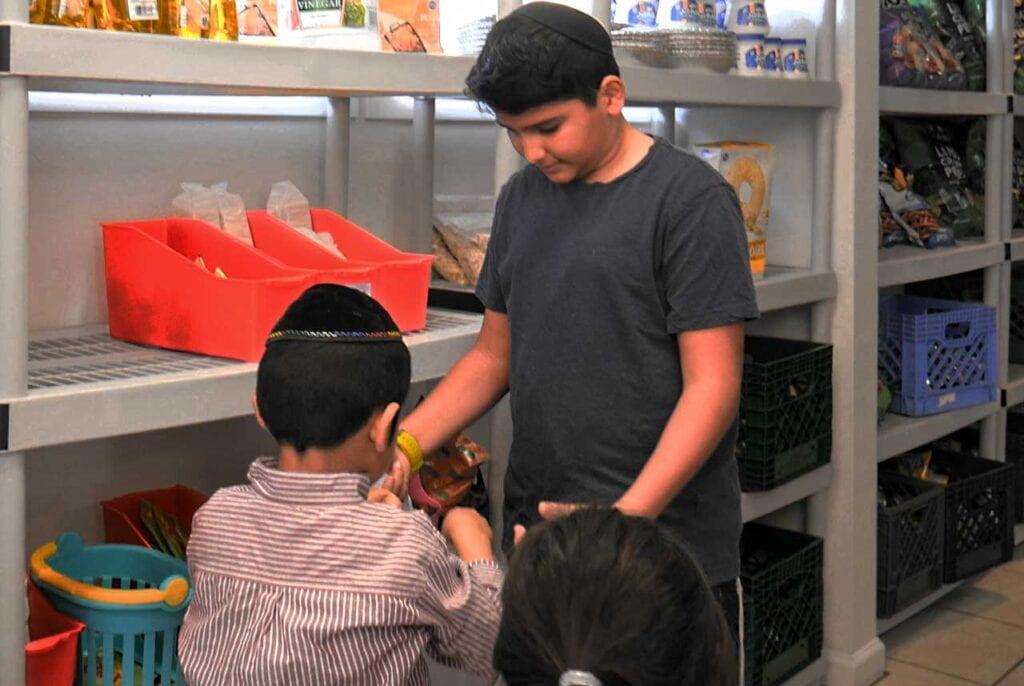 Siblings shopping at the Arizona Kosher Pantry